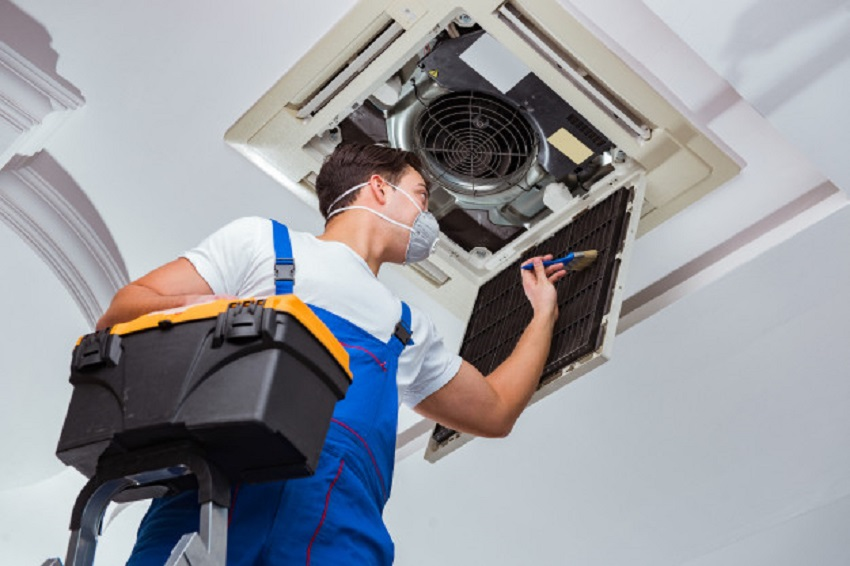 an electrician giving a home appliance repair services
