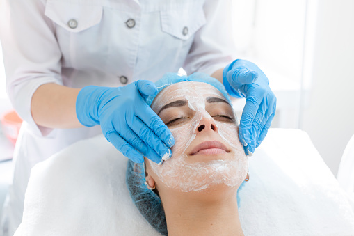 a woman applying4 Steps for up to mark HydraFacial Treatment