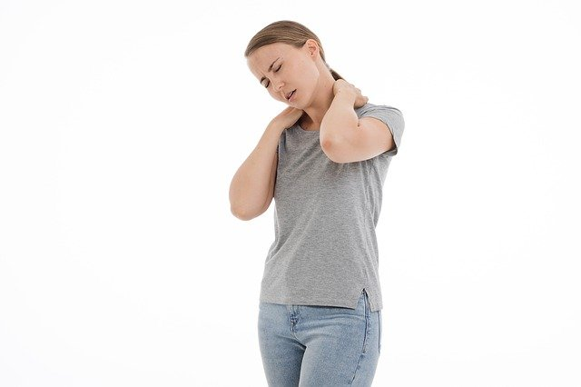 a girl in pain due to forward head posture problem.