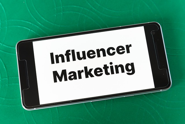 a mobile with a text written on its screen Influencer Marketing