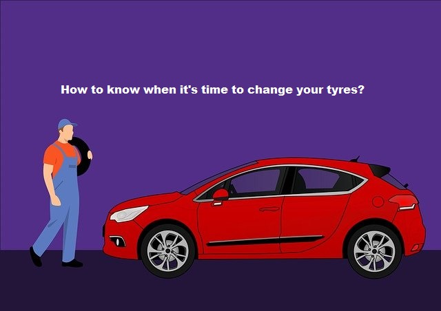 a figuring out infront of his car How to know when it's time to change your tyres